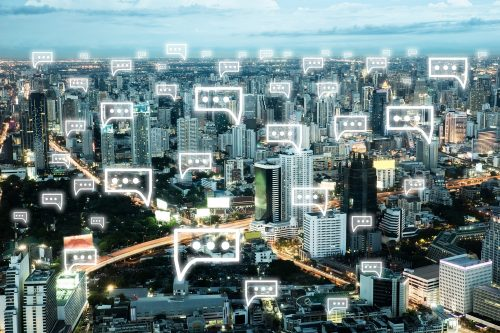 Communication chat icon above cityscape in the night light of th